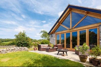 single storey oak frame extension with glazed gable end