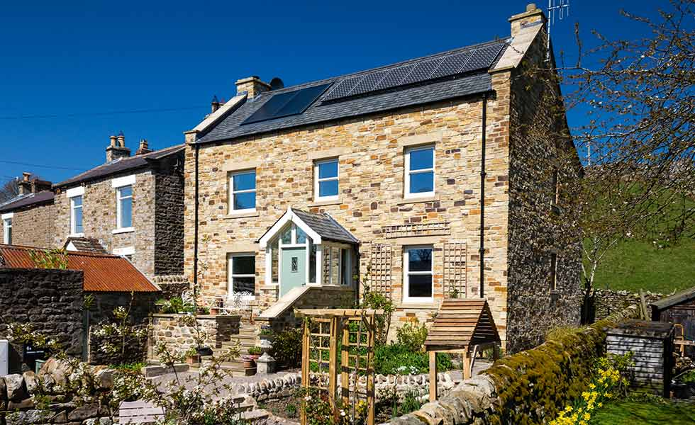 solar PV panels on this traditional style cottage make it eligible for feed in tariffs