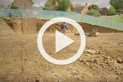 video play button excavated site