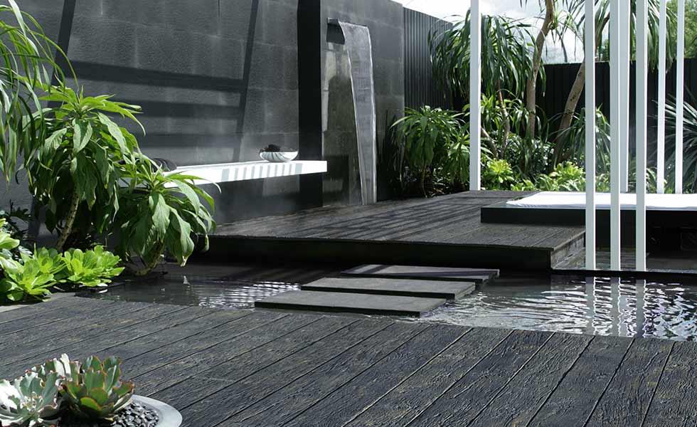 millboard decking Carbonised Embered water garden