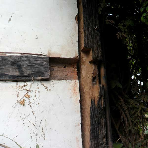 removing-damaged-surface-of-timber-frame