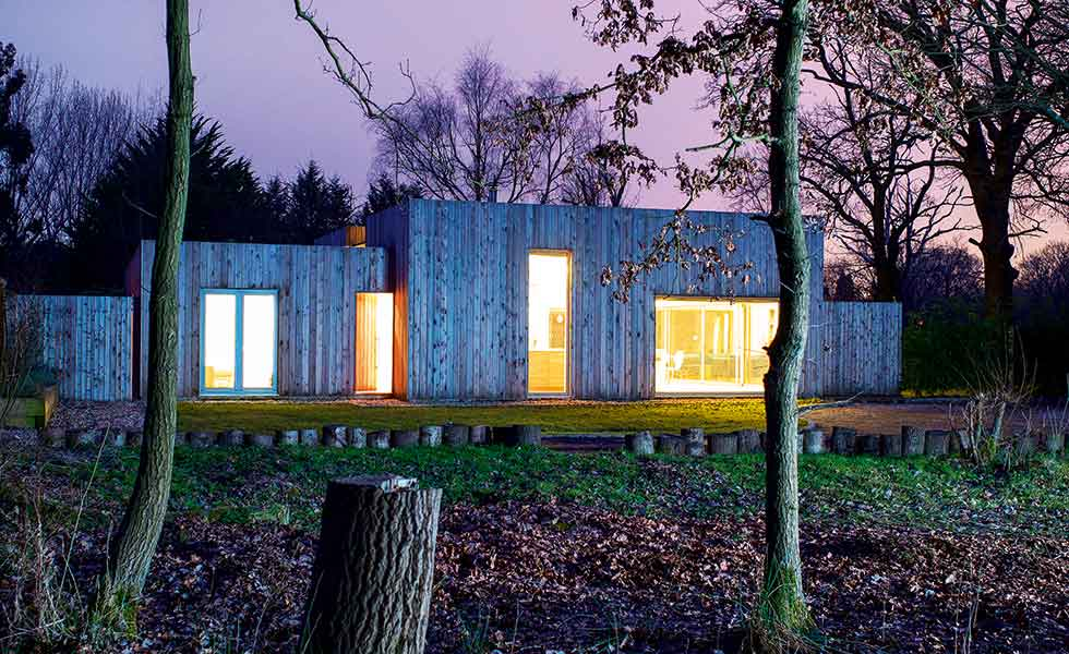 A larch-clad single-storey home in Surrey