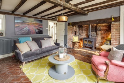 Period living room with exposed beams and inglenook