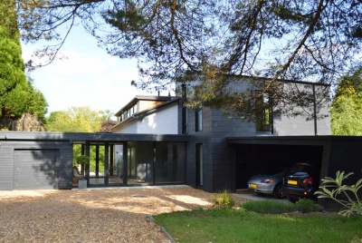 Extension and renovation of 1960s detached home in Haslemere, Surrey featuring dualaspect entrance hall.