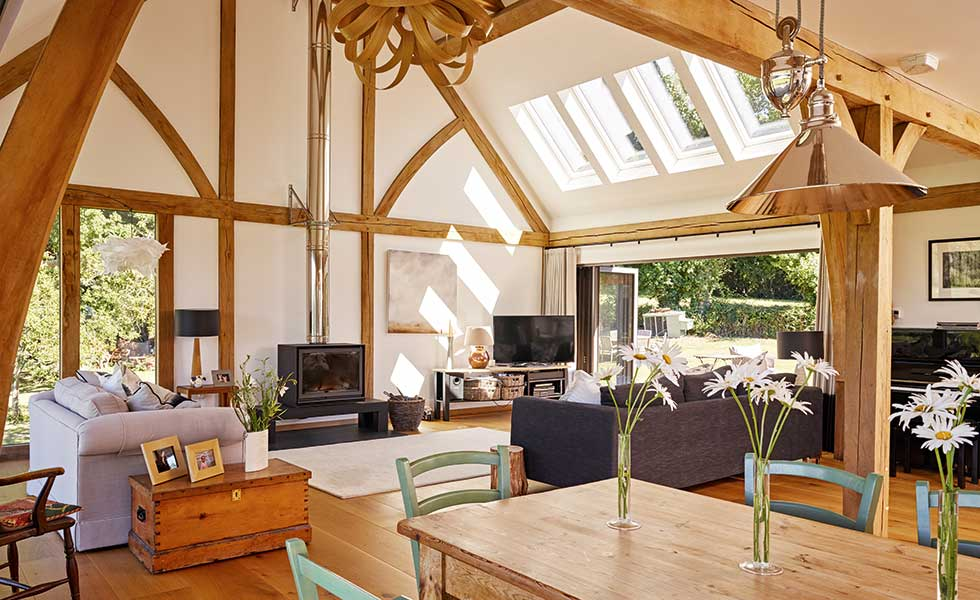 Rooflights in vaulted ceiling of open plan oak frame home