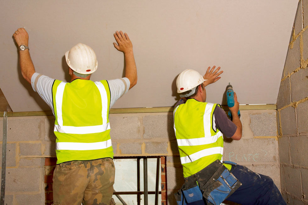 roof insulation boards being installed
