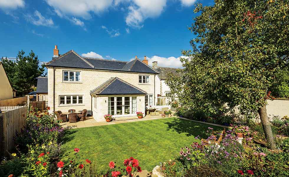 The rear of this package self build in the Cotswolds looks out over Toni and Andrew's established garden
