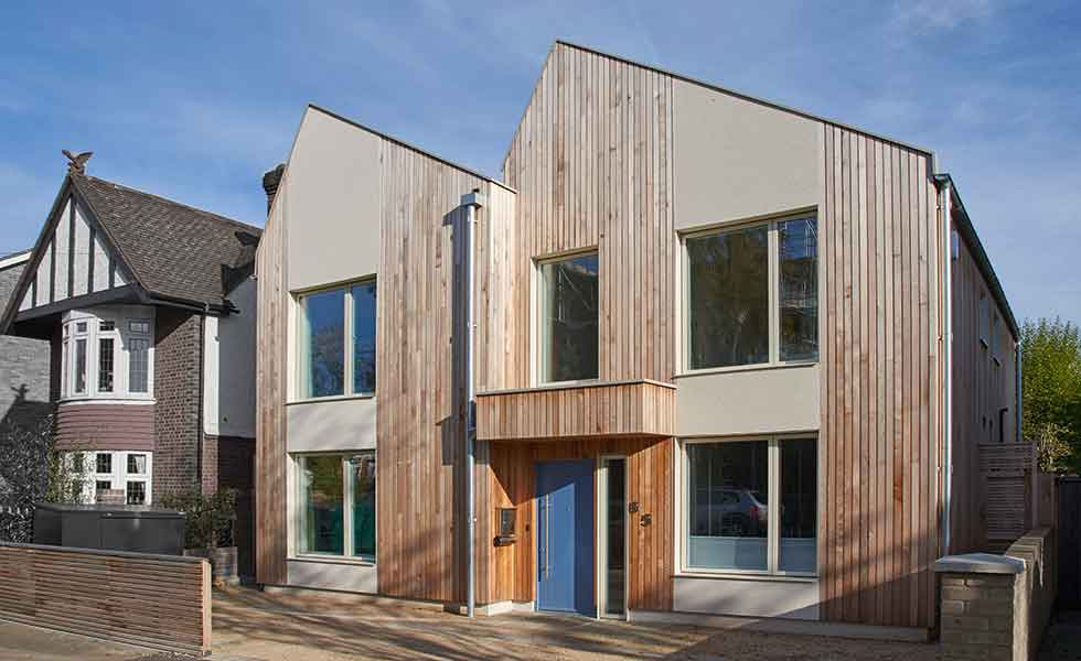 Long cedar panels break up the external facade of this prefabricated timber frame home