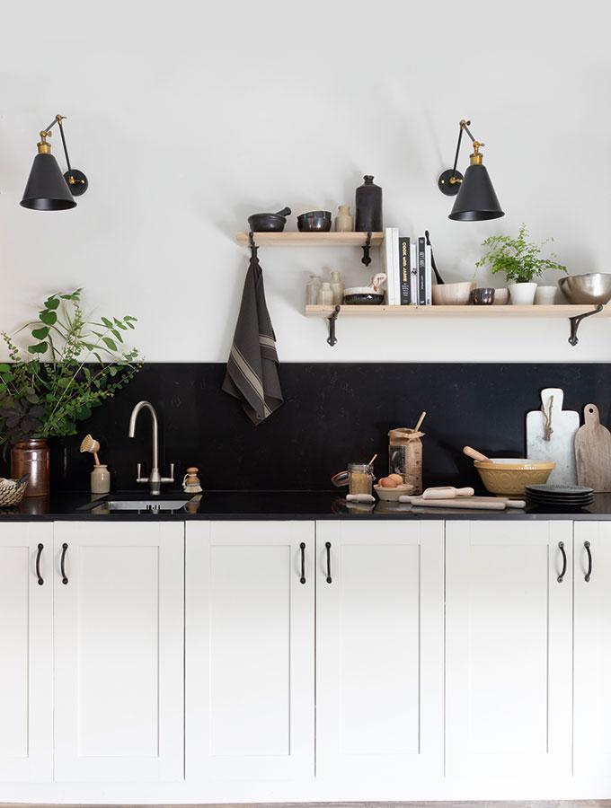 quartz black worktop in white kitchen