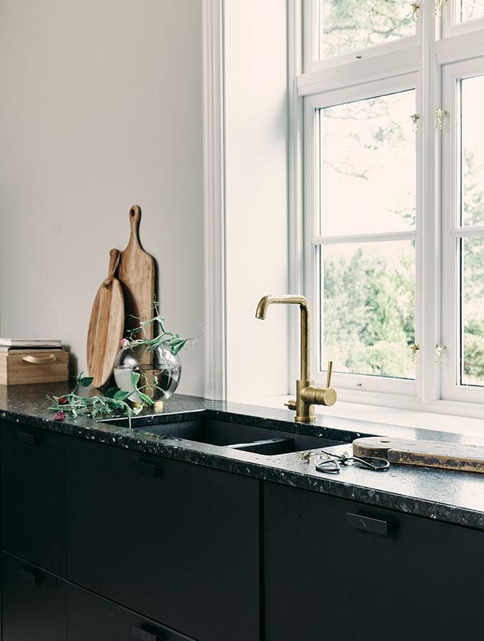dark real stone worktop with undermounted sink