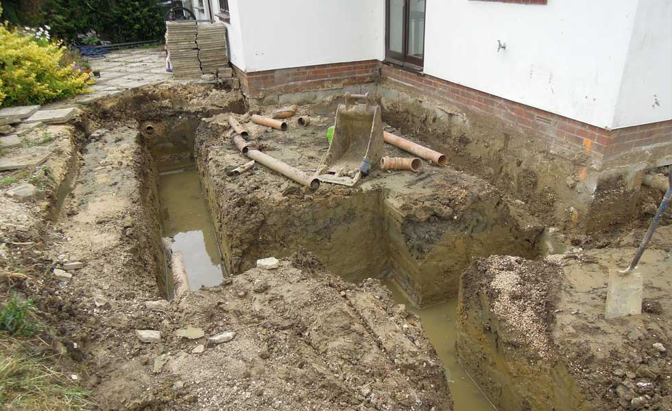 The trenches fill with water