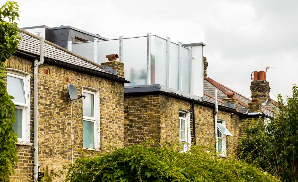 Mansard loft conversion with roof terrace