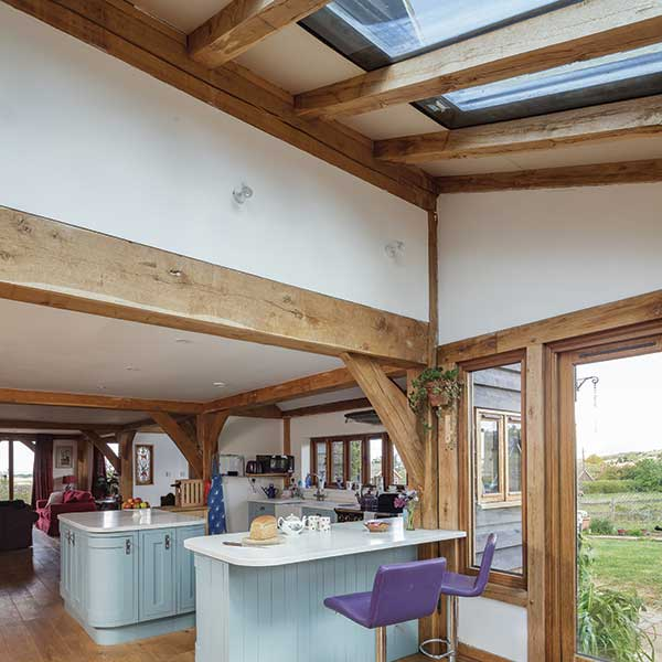 The open plan kitchen and garden room ensure this oak frame home is filled with light