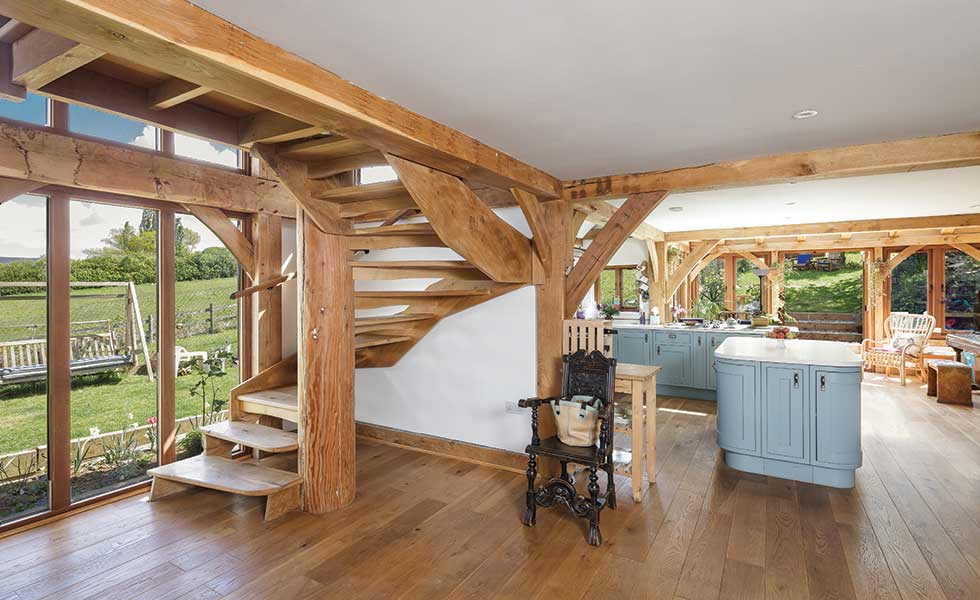 Timber staircase in an open plan oak frame home