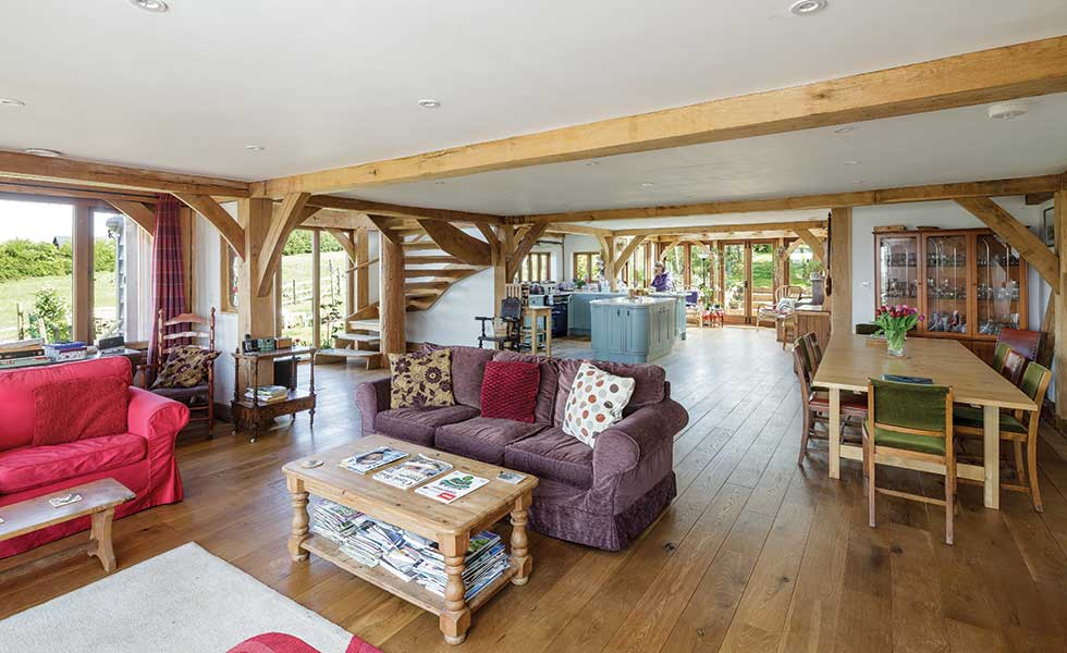 A spacious open plan living area in an oak frame home