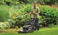 Chelford Farm Supplies man mowing
