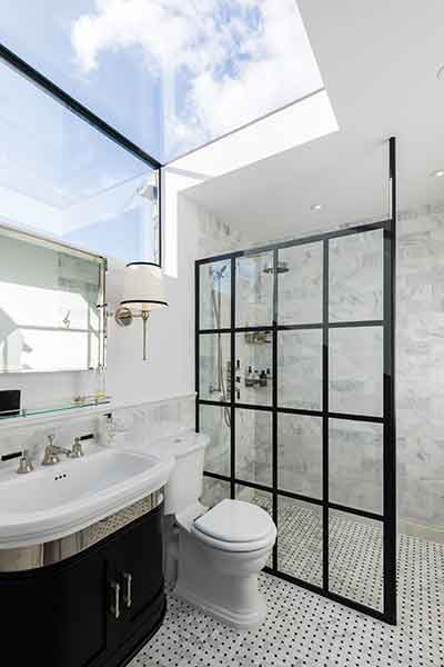 In this loft conversion in London a new bathroom is filled with light thanks to a structural glazed panel