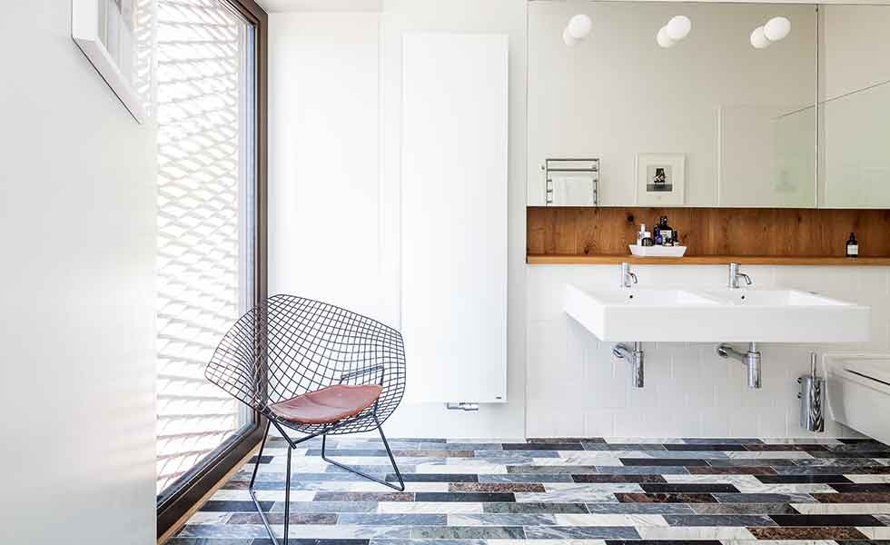 Marble cut-offs feature as flooring in the bathrooms