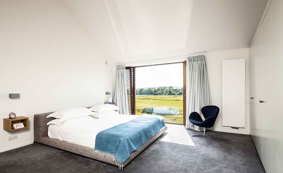 Picture windows feature in the master bedroom of this contemporary self build