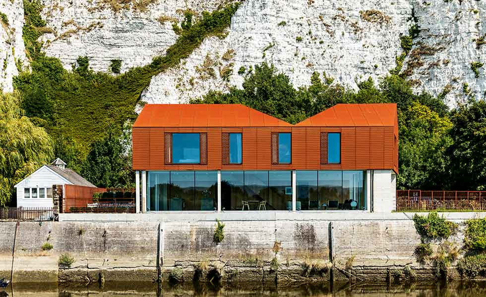 This contemporary self build in Lewes on the riverbanks has been clad in cor-ten steel