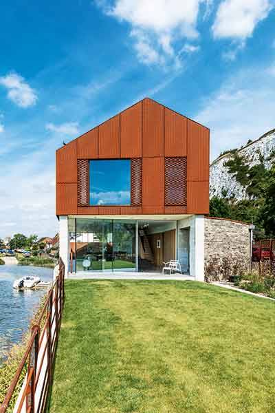 The exterior of this self-build in Lewes has been clad in for-ten steel on the first floor