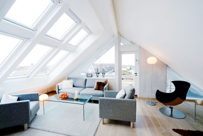 A bank of Velux windows helps to fill this loft conversion with natural light