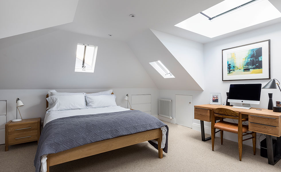 This loft conversion in London has made way for a bedroom on the top floor of the house
