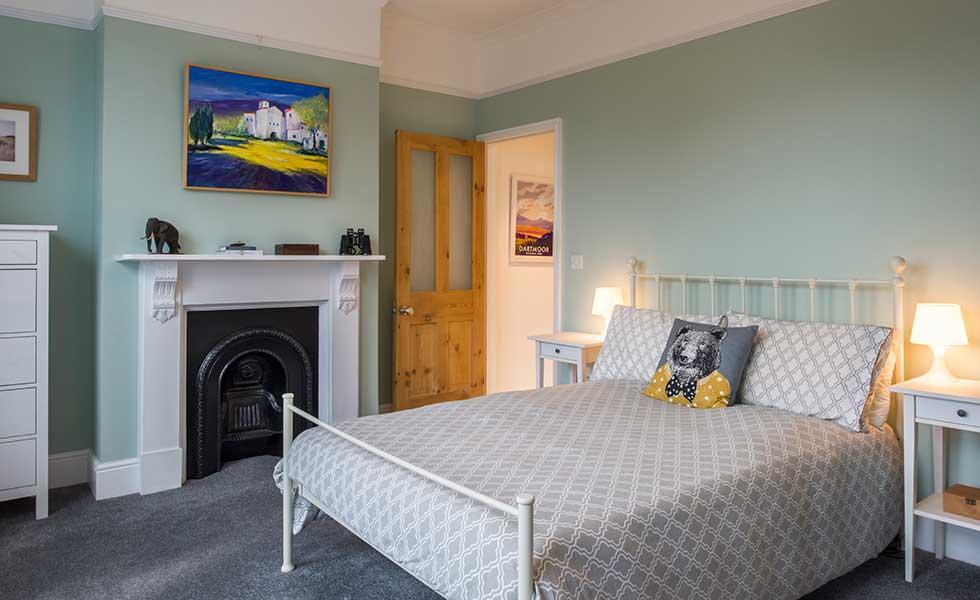 Original cast iron fireplace in bedroom