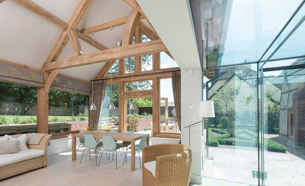 The inside of this oak frame extension boasts vaulted ceilings