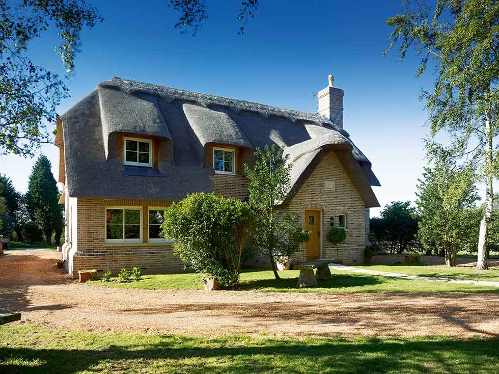 A thatched roof on this cottage evokes traditional style