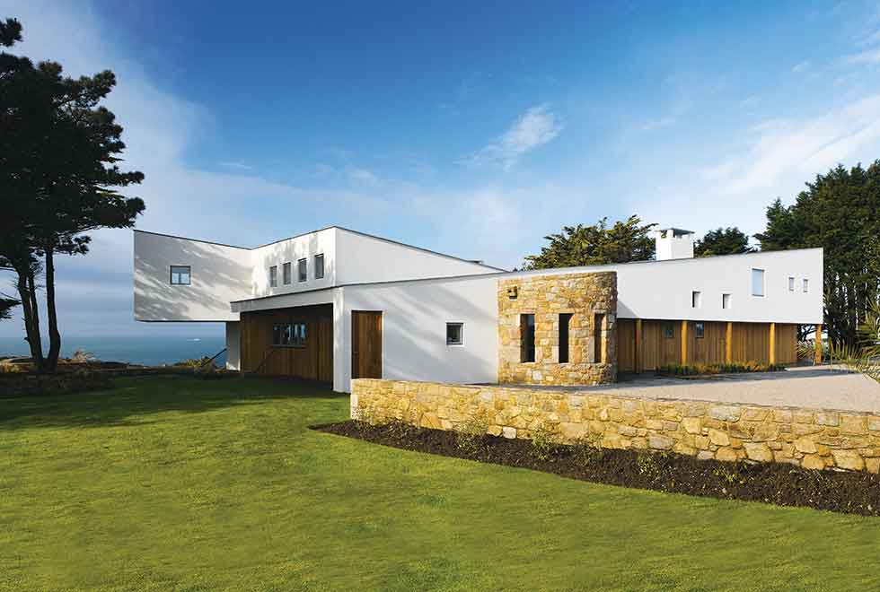 This seafront home in Jersey features an origami style roof
