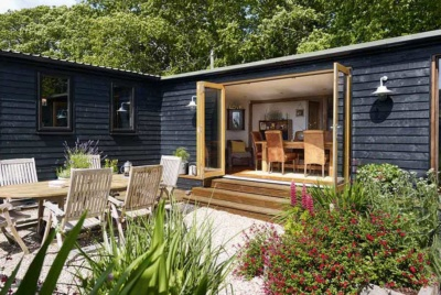 The log cabin self build has been extended over time to create a rustic comfortable family home