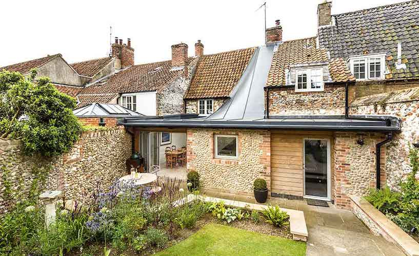 cottage extension with an interesting roof