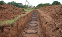 • GSHP slinky trench – For sites with limited land a slinky trench should not be instantly be discounted; efficiency improvements to the home can reduce the amount of ground array required, and even reduce the size of heat pump, offering further cost saving advantages