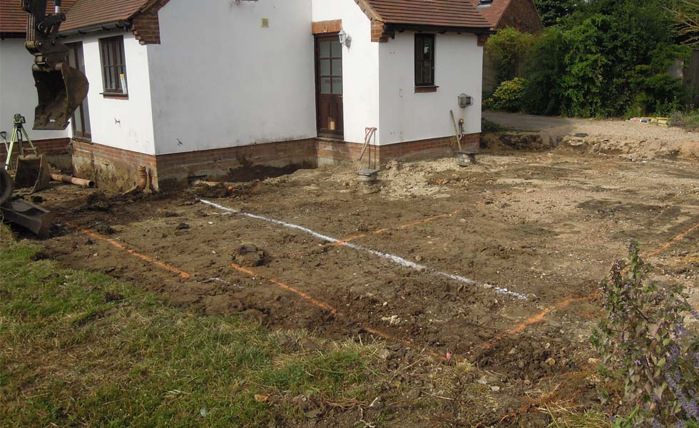 The oversite is cleared before the trenches are dug for the extension