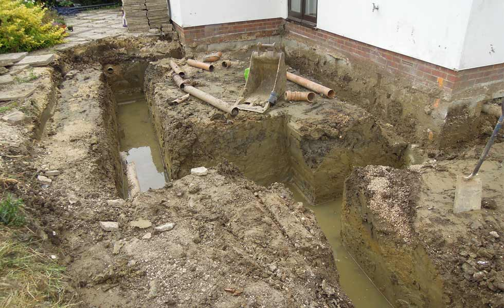 The trenches for the extension flooded