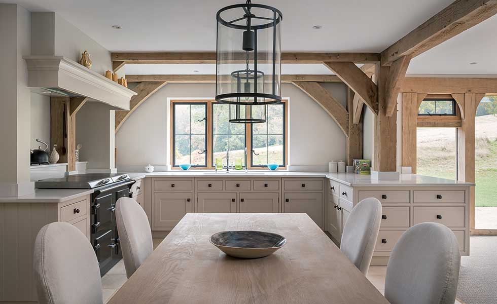 Shaker kitchen with exposed timber beams