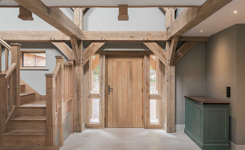 Entrance hall with oak staircase and exposed oak beams