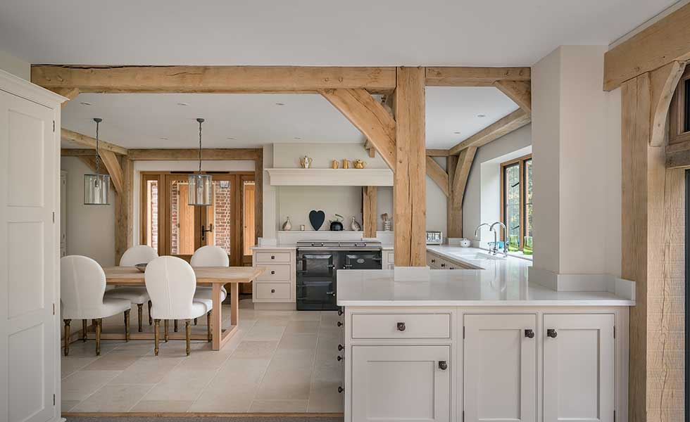 Open plan Shaker style kitchen with exposed beams