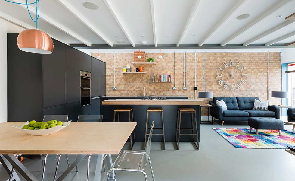 Exposed brick, polished concrete floors and dark joinery all aid in creating this modern kitchen design