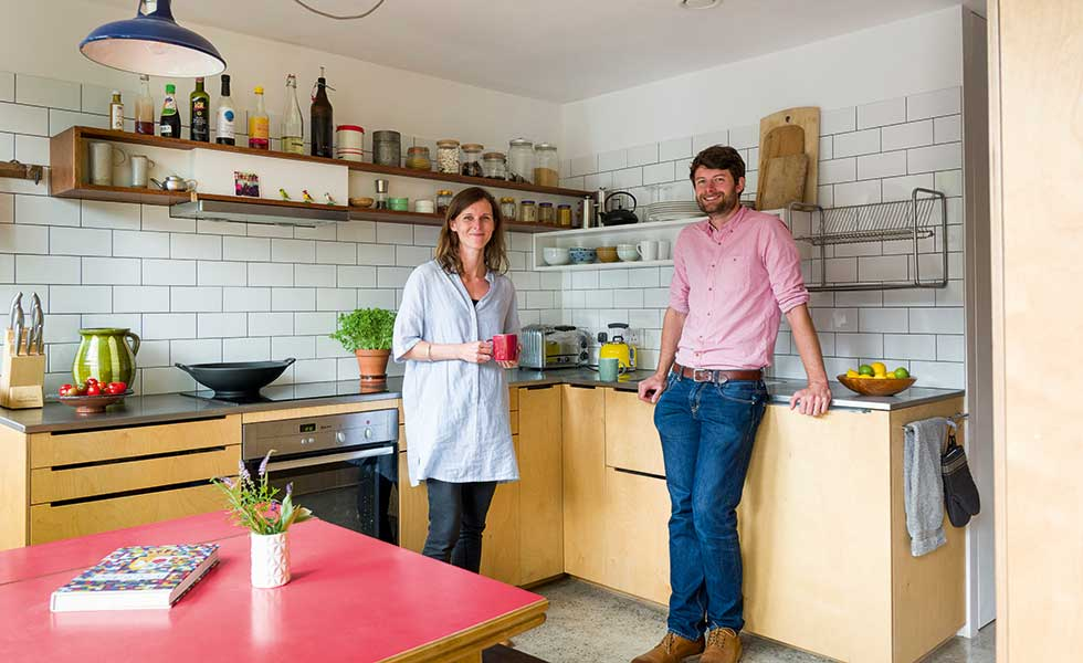 Clare Williamson and Oscar Baldry in their budget kitchen in a small eco home