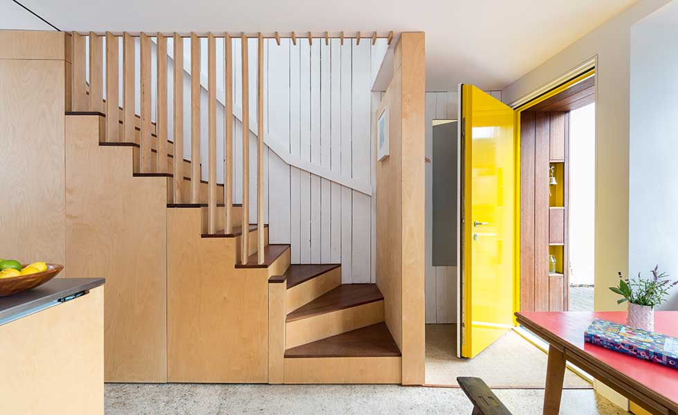 entrance hall, stairwell and kitchen of a tiny Passivhaus standard home