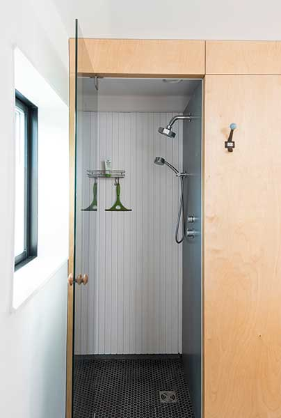 shower room with a glass door