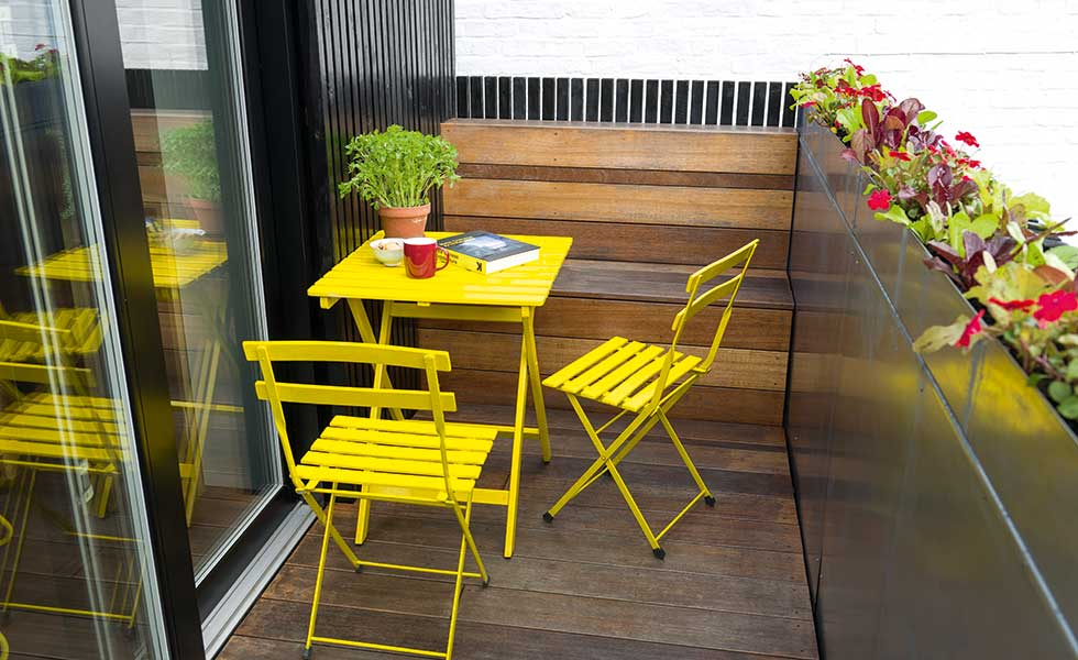 terrace with yellow bistro table and chairs