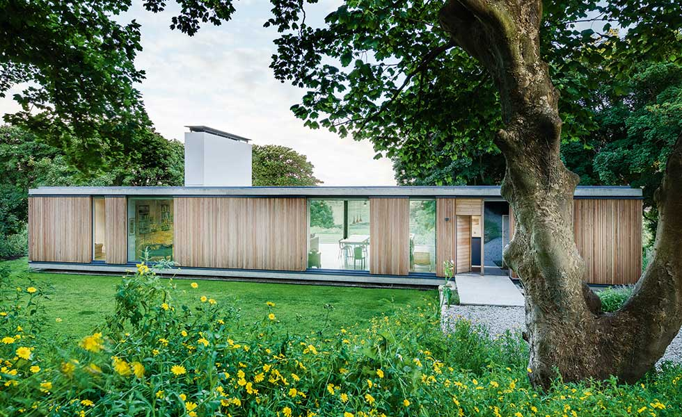 exterior of a cantilevered home with timber cladding