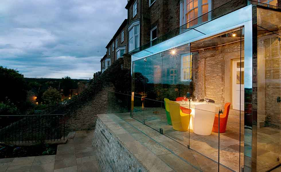 This glass box extension to a period property provides a new dining room