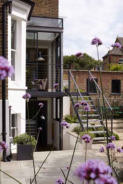 This two storey glass box extension is topped with a glass roof