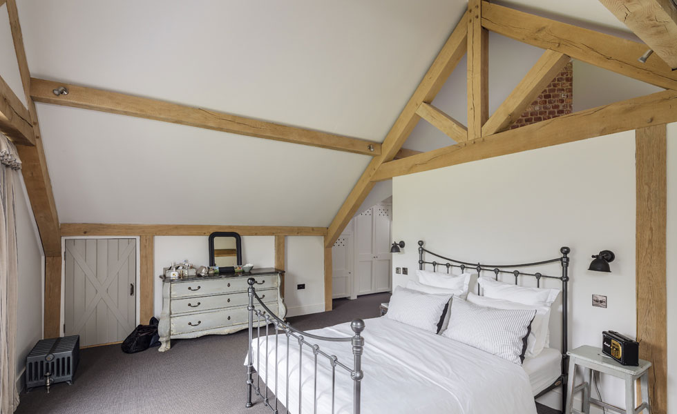 The master suite has views across the garden and a Juliette balcony