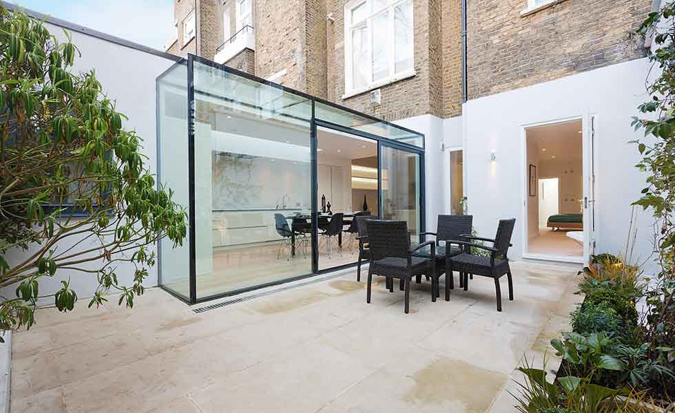 A narrow glass extension offers natural daylight to a ground floor flat in London