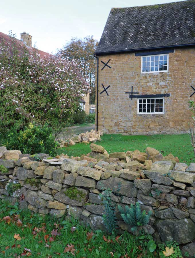 drystone boundary wall in need of repair